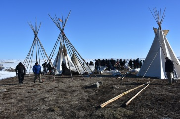 Tipi construction and demonstrators on Last Child Hill