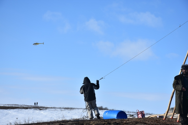 tipi-being-erected-as-dapl-flies-over